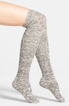 Soft and cozy over-the-knee socks look great worn with riding boots. Such a cute look for fall.