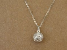 Simple everyday wear, all metal components are made with 925 sterling silver. Delicate filigree ball charm hangs on 18 inch cable chain with spring clasp closure. Measurement, Filigree ball charm is 15 mm total in length including bail on top. Please choose your preferred length for the