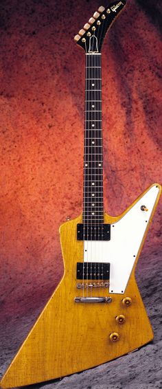 1958 Gibson Explorer: how did something so space age come from Gibson in the 50's. Actually was a little too ahead of its time and was only made for 2 years and not seen again until the 78 reissue. Screams 'Rock' stage guitar and you can't help but knock out a few Edge riffs when you pick one up.
