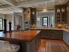 Kitchen- open into living room---love the openness and the ceiling!