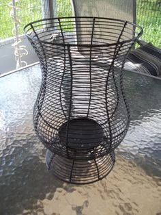 Wire basket, wire vase type container, easily made into a hanging lamp