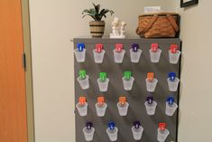 Going green in the health office. After using more than 75 cups in one day, I came up with this idea. I got magnetic clips and put names on them of children with scheduled meds. On Monday we get a new cup and on Friday we trash it. So we are using 25 cups in a week. Do the math. :)