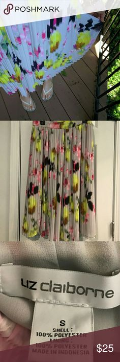 "Liz Claiborne floral pleated midi skirt On trend skirt with flowers and pleats perfect for summer and paired with boots for fall! It's a size small, but is slightly vanity sized and has a stretchy pull on waist band, so it would def work for a medium too. 29"" long midi length....so trendy right now! Worn once for a blog photoshoot. Make me an offer! I love to bundle and have a ton of $4 items I'd like to unload! Liz Claiborne Skirts Midi"