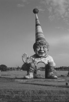Abandoned clown character monument/ entranceway. ~♛ Most likely an entrance to a former fun park or amusement park.