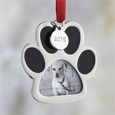 A dog's paw frames a small photo of your beloved pet and dangles a commemorative 2015 charm, making it a delightful addition to the tree.