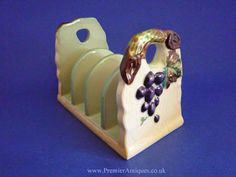 Carlton Ware 'Grape' Toast Rack A lovely embossed Grape design toast rack, the grapes and vine richly painted against a pale crea. Retro Toaster, Pie Bird, Toast Rack, Condiment Sets, Toasters, Carlton Ware, Cheese Dishes, Antique Perfume Bottles, Serving Utensils