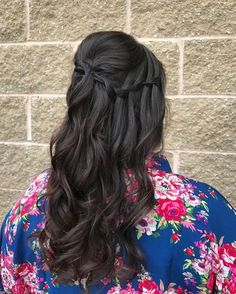 woman with long dark brown ombre hair in a waterfall braid from front to back, with loose curls