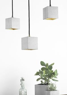 This one of a kind Concrete Cubic Pendant Light by German label GANTlights combines light grey concrete with silver, gold or copper, resulting in a timeless and elegant designer lamp.