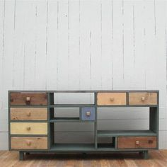 Love the mixed medium drawers and shelves of this beautiful wood credenza.