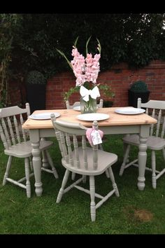 Pine table and chairs, restored using a light grey colour.