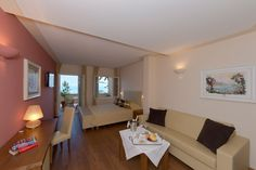 Luxury Hotel Lake Garda Hotel Baia D'Oro in Gargnano Lake Garda Hotels, Wine Cellar, Terrace, Gold, Wine Cellars, Hotel Bedrooms, Lake Garda, Luxury, Patio