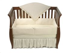 Here is a bedding set that comes with everything you need fit in a standard size crib. Makes an ideal gift! American Baby Company Heavenly Soft Minky Dot 4-Piece Crib Set, Ecru