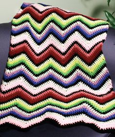 Crochet Rainbow Ripple Afghan. not my fave colors, but like the pattern.