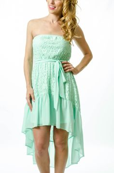 The high-low silhouette is here to stay, and our lovely mint dress proves just that. This silk/polyester tube dress features an asymmetrical contrast hem and waist tie for a flattering fit. Our mint lace high-low dress is great for everything from summer weddings to romantic date nights. Add a pair of nude wedges and your favorite bag and you're ready to head out!   #mintdress #mintlacedress #lacedress #minthighlowdress #highlowdress