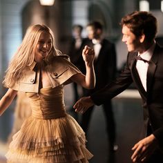 The dance begins with couples wearing elegant tulle and black tie