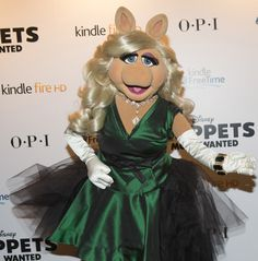 Last night, Style Icon Miss Piggy wore an emerald green silk grosgrain and  tulle ensemble, from Vivienne Westwood Couture, for her red appearance at the UK premiere of 'MUPPETS MOST WANTED' which hits UK theatres March 28th 2014