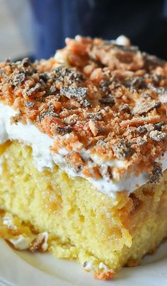 Butterfinger Poke Cake/1 recipe yellow cake, or your favorite box cake mix, and ingredients to prepare it.  1 can sweetened condensed milk  1 (16oz) jar caramel sauce  1 pint heavy whipping cream  1/3 cup confectioners sugar  1 teaspoon vanilla extract  3 Butterfinger candy bars, crushed into large crumbs