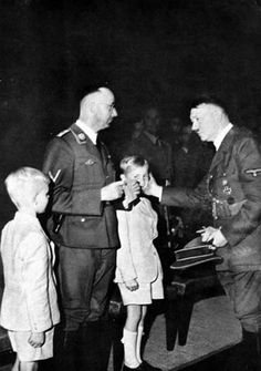 Hitler and Himmler at the funeral of Reinhard Heydrich ,with his sons.