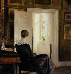 Carl Holsoe (Danish: 1863-1935) | A woman seated near a door