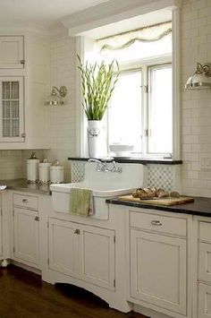 Rustic white cabinets with black countertops