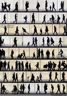 Silhouettes of passers-by in the Raval, Barcelona by Geoff