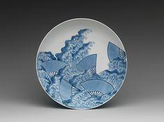 Dish with Fan-and-Wave Design  Period: Edo period (1615–1868) Date: ca. 1780 Culture: Japan Medium: Porcelain with underglaze blue and overglaze enamels (Hizen ware, Nabeshima type) Dimensions: H. 2 1/8 in. (5.4 cm); Diam. 7 7/8 in. (20 cm) Classification: Ceramic