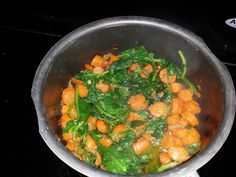 Sauteed in Coconut Oil Carrots, Shallots, Spinach, and Kale that I used to top a Baked Sweet Potato.