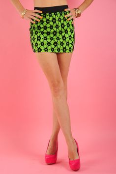 Feisty-Neon Green  Sexy, Lace Overlay Mini Skirt with Elasticized Waistband.   100% Polyester.   $27.50  www.ClassyChickClothingOnline.com