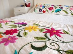 Summer bedspread idea- love the crisp white with the bright floral pattern