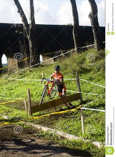 Cyclo cross competitor taking part in a race in Acquedotti in Cinecitta park, Rome.