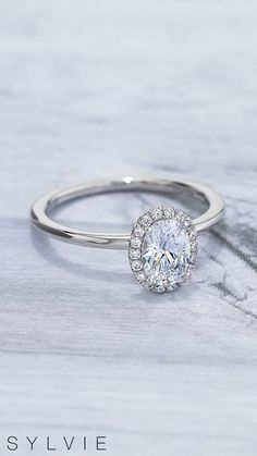 Looking for a classic #OvalEngagementRing but love the glamour of a #Halo? The Elsie ring by #SYLVIE is the best of both worlds. #SomethingSYLVIE #EngagementRings #Rings #DiamondRings #WeddingRings #DiamondRing #UniqueEngagementRings #HaloRings #HaloEngagementRings #DesignerEngagementRings #OvalRings Double Halo Engagement Ring, Designer Engagement Rings, Oval Rings, Diamond Rings, Wedding Rings, Wedding Ring, Wedding Band Ring