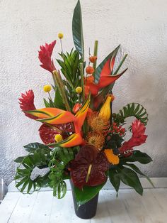 A bright Autumnal Contract arrangement with flowers including Heleconia, Anthuriums and Berries. Contemporary Flower Arrangements, Tropical Floral Arrangements, Florist London, Same Day Flower Delivery, Surrey, Corporate Events, Beautiful Flowers, Berries, Bouquet