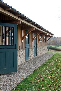This multi-stall timber frame barn and maintenance barn has a custom cupola with copper standing seam roofing and wide roof overhangs that creates good protection. Dream Stables, Dream Barn, Barn Renovation, Small Barns, Horse Stalls, Barn Plans, Horse Farms, The Ranch, Farm Life