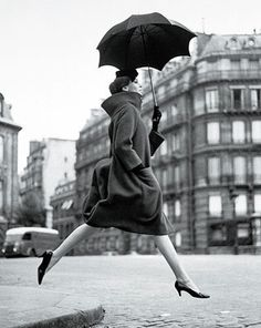 love this vintage fashion photo with the perfectly held black umbrella