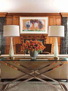David Scott Interiors' design features a striking mirrored table.