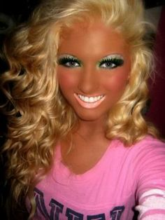 Omg shes so pretty NOT, well with the tan she isnt