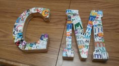Using modpodge, glue letter magazine scraps on to wooden letters.   . . . . Created by Katie Rachman