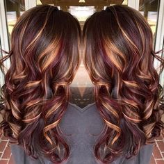 wavy light brown hair with golden blonde and dark red highlights