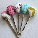 Covered buttons with hairpins...too cute! will have to make some...[someday]