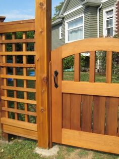 """This project was a labor of love by the homeowner. He built the fencing and gate himself and was searching for just the right gate hardware to outfit the cedar gate. He chose the Dark Bronze 8"""" Thumb Latch with Straight Drop Bar. It seems like the perfect choice for their gate's design."""