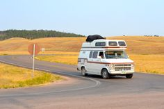 Perfect photography conditions near Wind Cave State Park in South Dakota. Doesn't the van look great on the road?