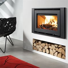 Westfire Uniq 32 Inset 1m wide - The Westfire Uniq 32 inset, a highly efficient woodburning stove with a stunning wide screen view of the fire. With its triple air supplies including pre heated secondary air wash to keep your glass clean you can be sure that this fire will give you more than just heat but a brilliant view as well.