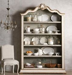 The Rousseau Bookcase from Eloquence Inc is stately and handsome with lots of space for your beautiful books! Bottom shelf is fixed; additional 3 shelves are adjustable. FREE SHIPPING. $4625