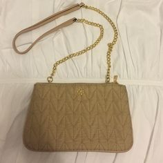 Beautiful Ann Taylor Quilted Purse Cream Ann Taylor purse with gold chain strap. In perfect condition! Ann Taylor Bags Crossbody Bags