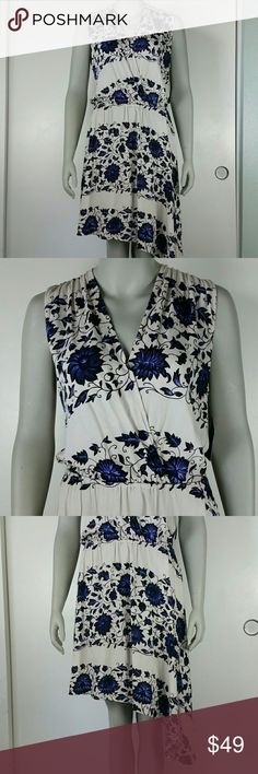 "Ella Moss Crossover Floral Dress NWT Large A natural taupe dress with blue floral print. Elastic waist with crossover bust neckline. Assemeteical hemline with a keyhole back and a tie below the neck. New with tags, size large.  Pit to Pit 18"" Top of shoulder to bottom hem 47"" at longest Ella Moss Dresses"