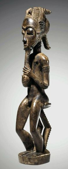 Africa | Seated figure from the Baule people of the Ivory Coast | Wood