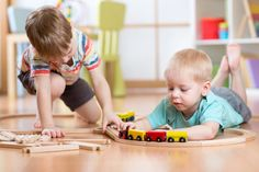 Cute Children Playing With Wooden Train. Toddler Kids Play With Blocks And Trains. Boys Building Toy Railroad At Home Or Stock Image - Image of children, kindergarten: 68314743 - Feeding baby. In mothers arm , - Kids Toy Chest, Daycare Business Plan, Autism Learning, Starting A Daycare, Small Business Trends, Business Ideas, Stage, Kindergarten, How Many Kids