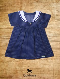 Clear Marine Love. Kids tunic was made of ultra thin cotton fabric. It is dark blue with tiny white dots.