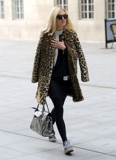 Fearne Cotton leopard print coat with black and white sweater, tights and sneakers