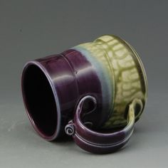 This beautiful wheel-thrown mug has attractive glossy eggplant purple and textured fern green glazes.    The mug is approx. 4 tall, with a mouth